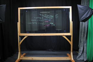 Lightboard, a glass board with writing on it